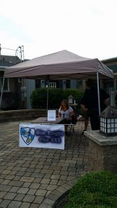 Brief attempt, in between thunderstorms storms, to sell raffle tickets during Street Fair 2016